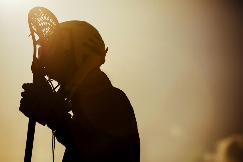 shutterstock-lacrosse-player-in-shadow-080519