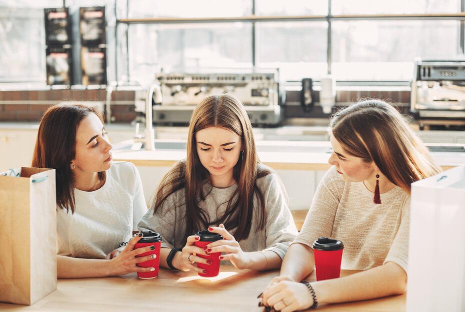 shutterstock-three-girls-having-serious-conversation-081419