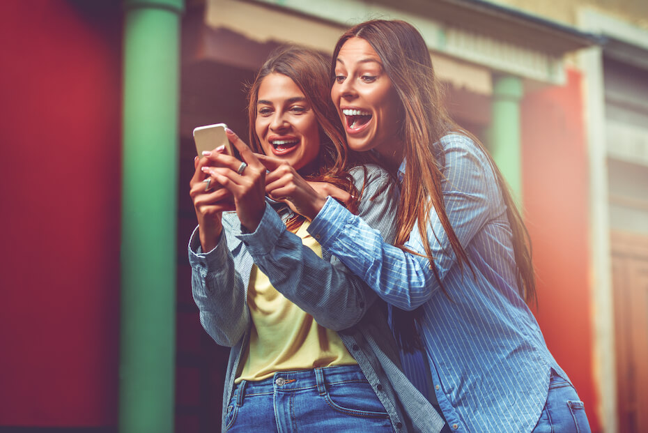 shutterstock-two-excited-girls-looking-at-phone-080919