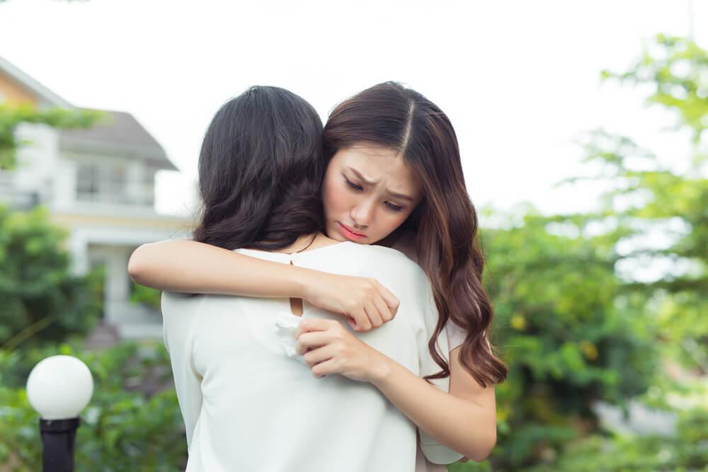 shutterstock-two-girls-hugging-sad-091419