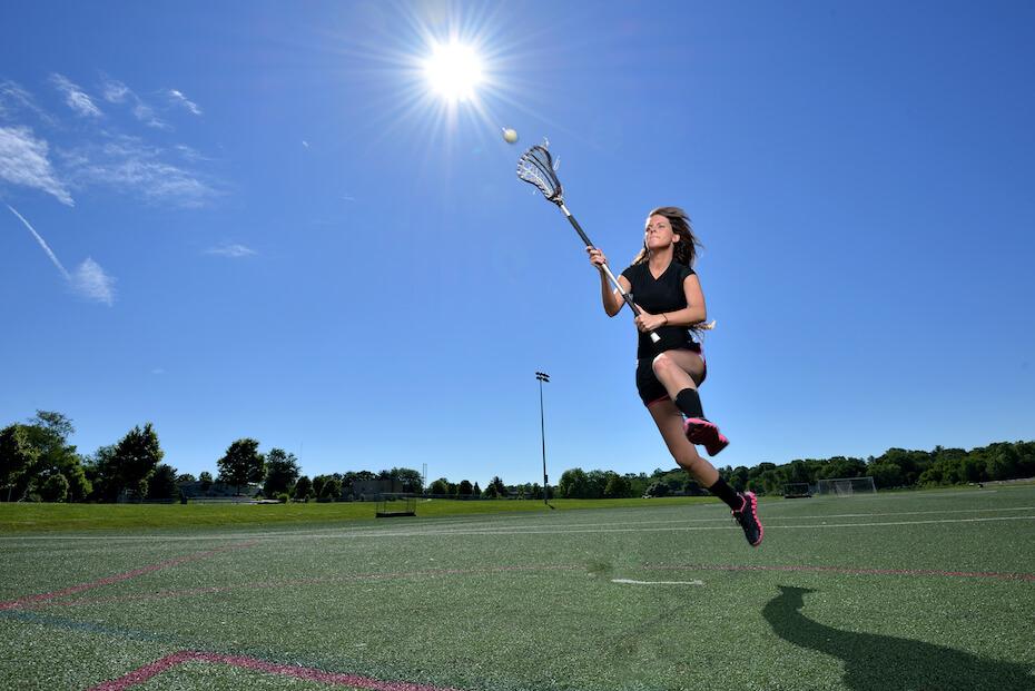 shutterstock-woman-catching-lacrosse-ball-080519