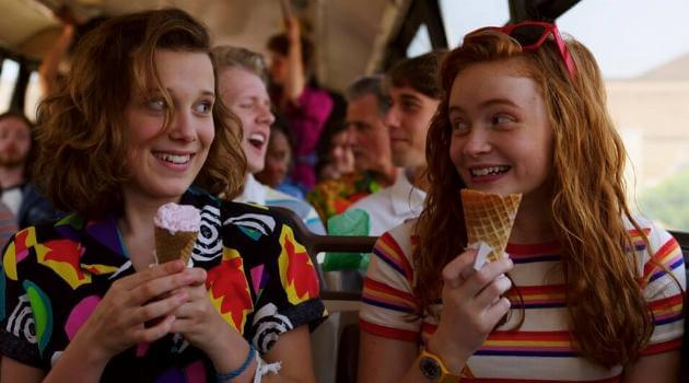 Stranger Things: Max and Eleven eating ice cream on the bus