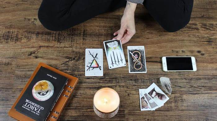 Unsplash: Woman reading her tarot cards