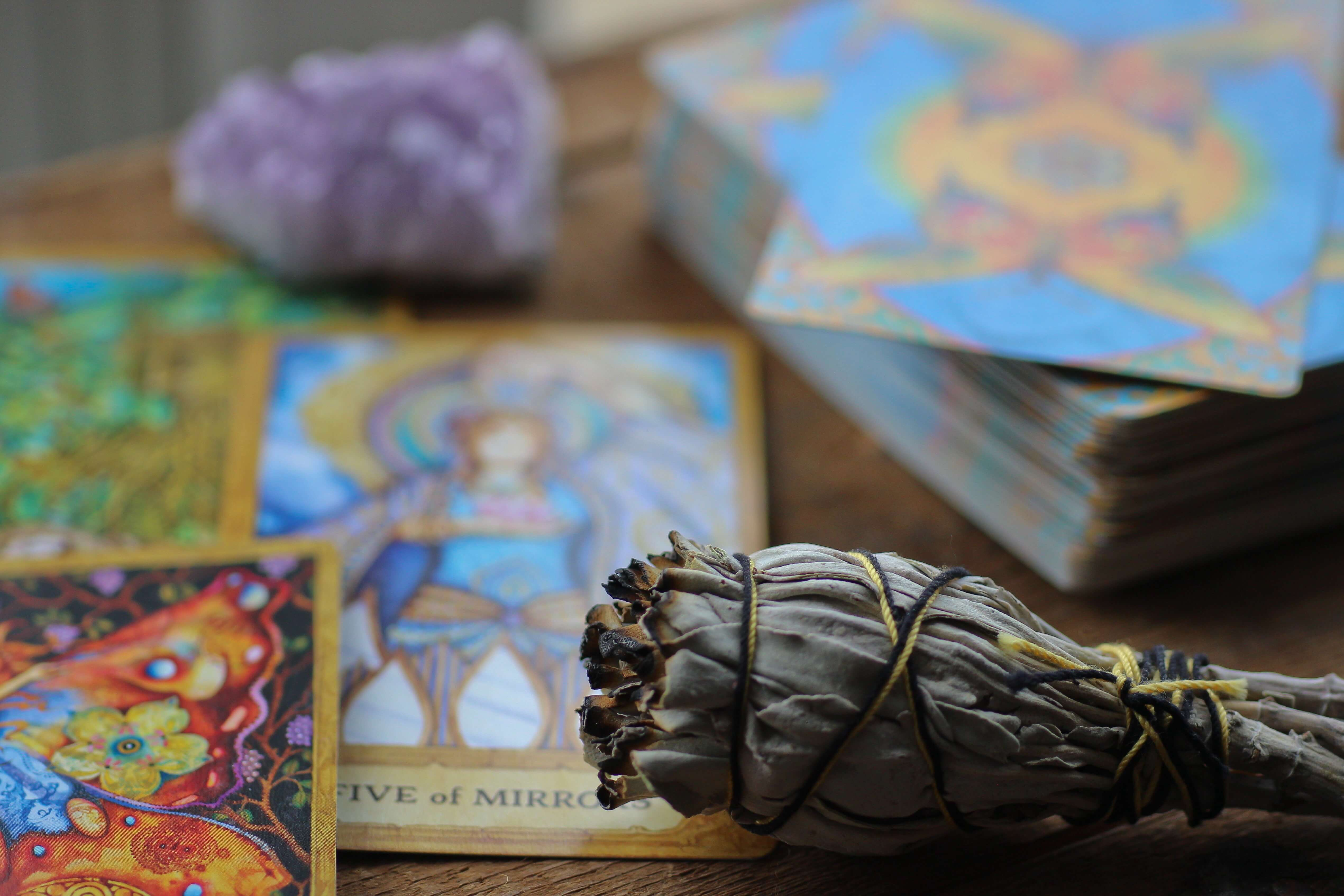 unsplash-kayla-maurais-tarot-cards-and-sage-081319