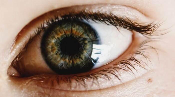 Unsplash: Closeup on eye with dark long eyelashes