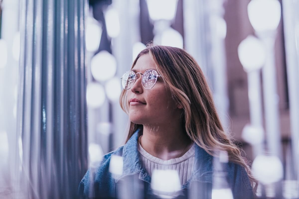 Unsplash: Woman in glasses looking thoughtful and thinking