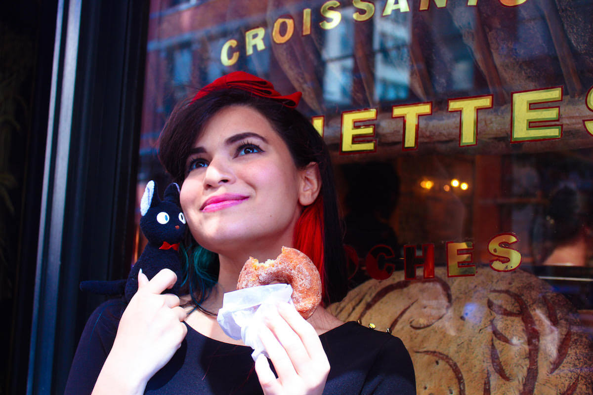 cristal-marie-eating-donut-with-jiji-cat