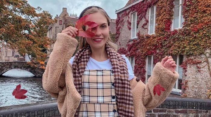 Instagram: Girl in fall looking through a leaf