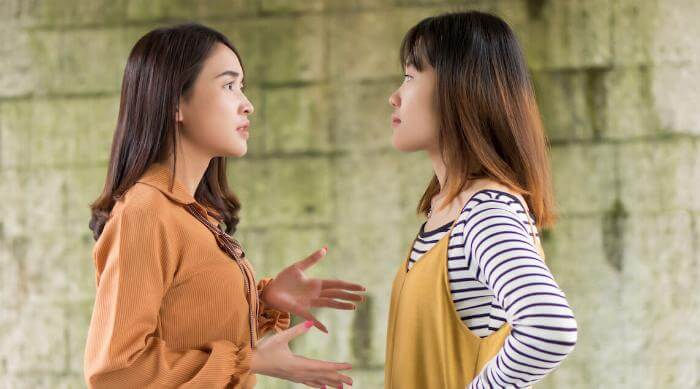 Shutterstock: Two women arguing or debating each other