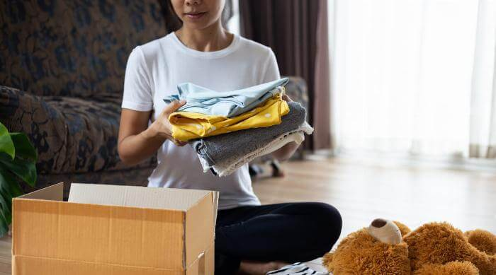 shutterstock-woman-packing-up-old-stuff-to-donate-featured-091819