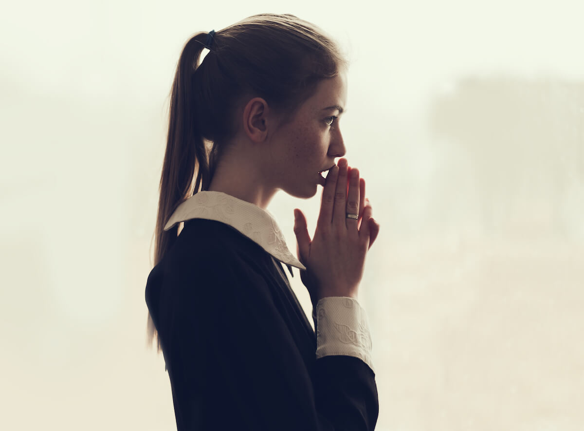 Shutterstock: Woman thinking with her hands to her face