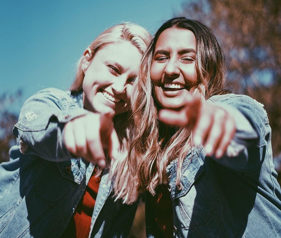 unsplash-baylee-gramling-best-friends-smiling-pointing-camera-091219