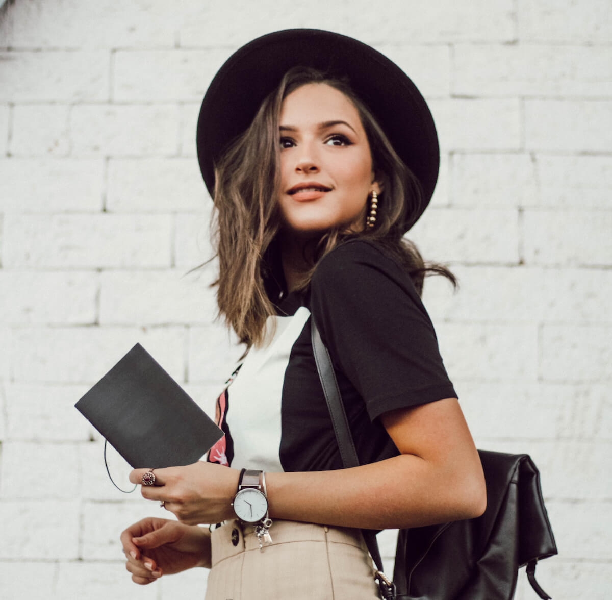 Unsplash: Fashionable girl in a hat smiling at the camera