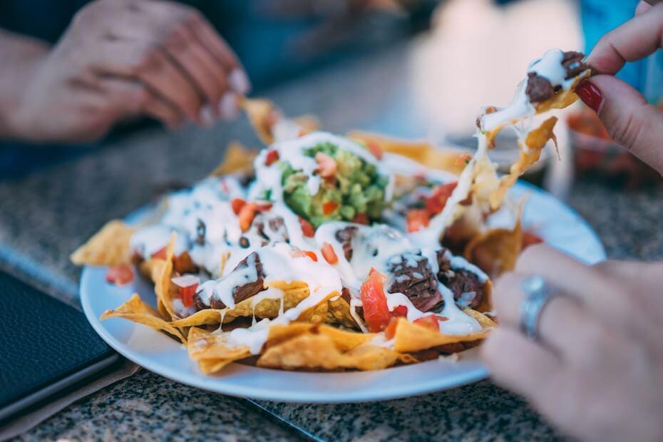 unsplash-herson-rodriguez-sharing-plate-of-nachos-090319