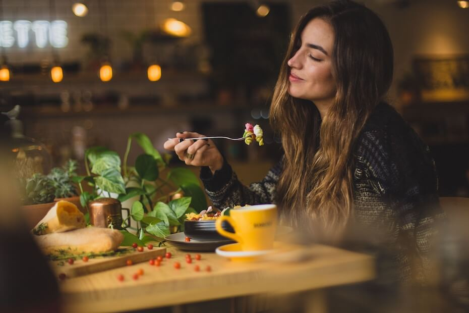 Unsplash: Woman enjoying pasta in a restaurant