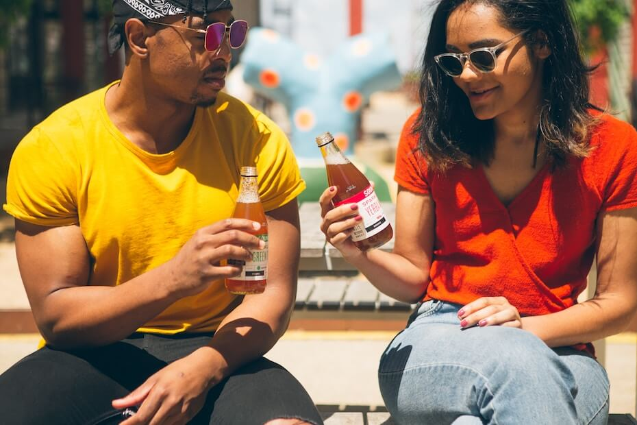 Unsplash: Man and woman talking over sodas