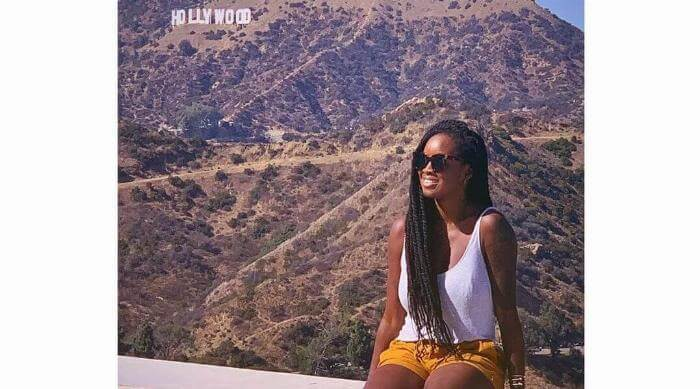 Woman Sitting in Front of Hollywood Sign