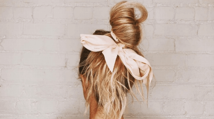 cute messy bun with pink bow
