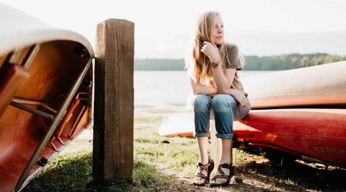Unsplash: Girl daydreaming sitting on docked boat