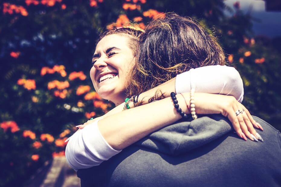 Unsplash: Woman hugging and laughing