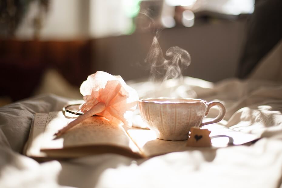 Unsplash: Teacup on table next to journal