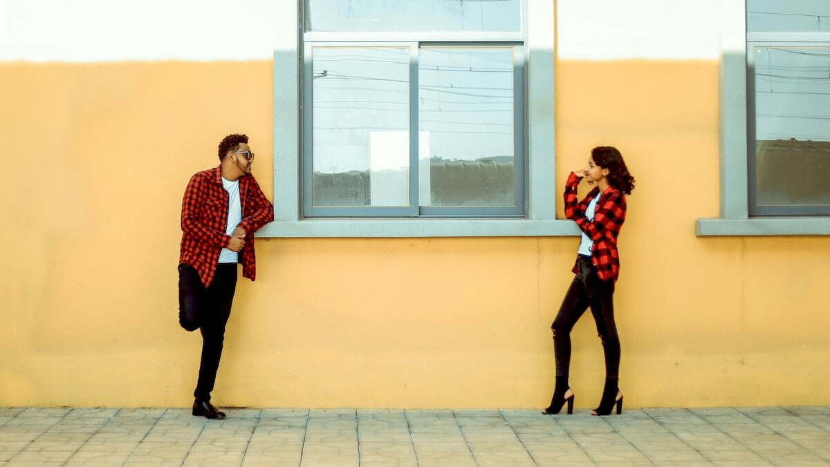 unsplash-gift-habeshaw-man-woman-in-matching-outfits-talking
