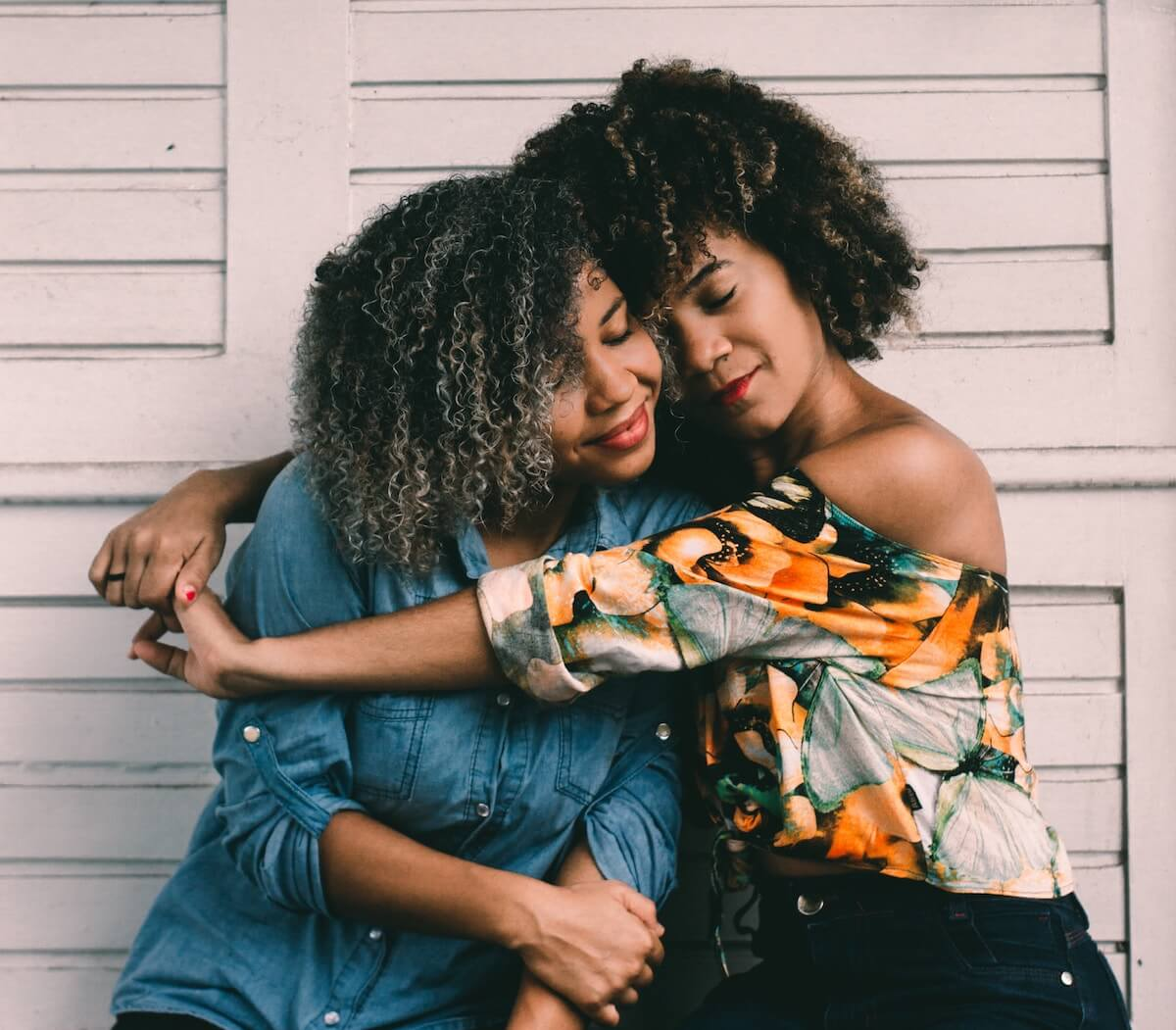Unsplash: Two friends hugging sweetly and smiling together