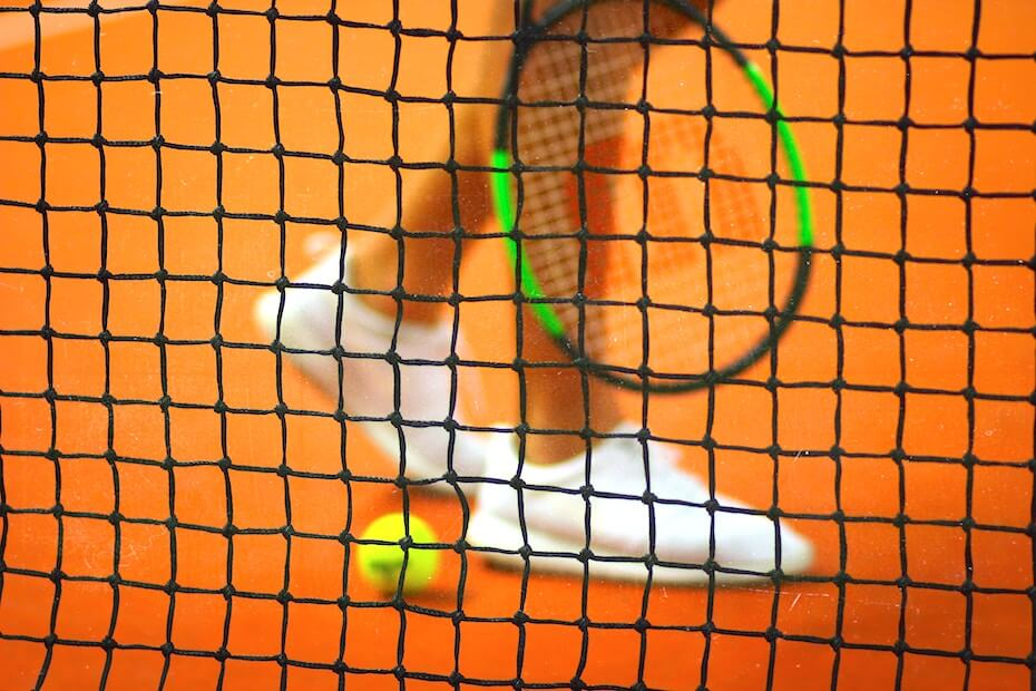 unsplash-john-fornander-womans-feet-with-racket-and-net-102219