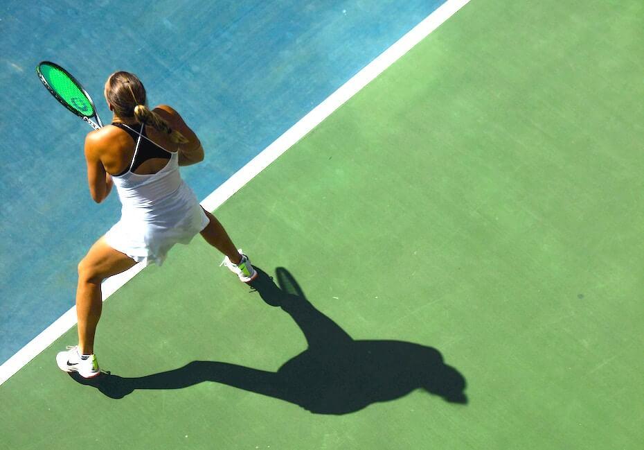 unsplash-renith-woman-standing-on-tennis-court-102219