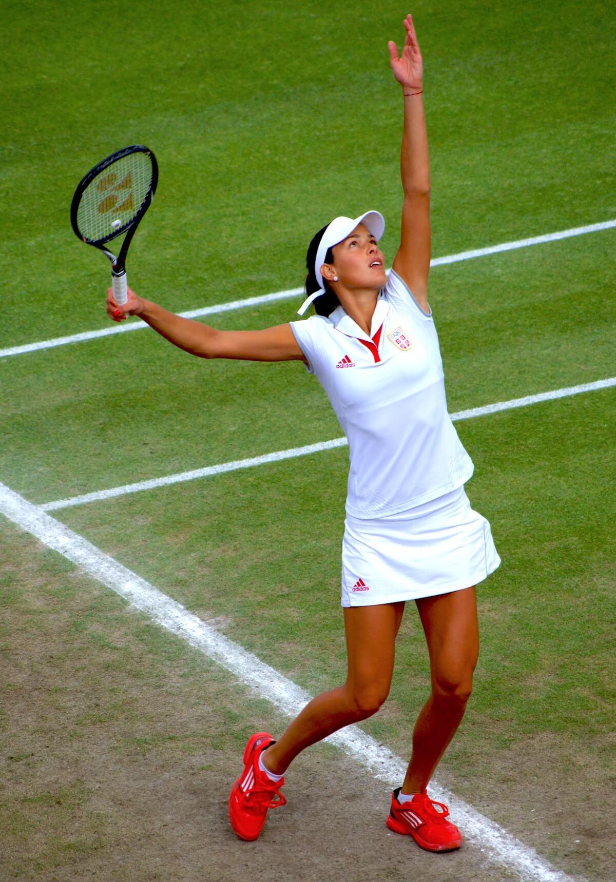 unsplash-zoe-reeve-woman-serving-tennis-ball