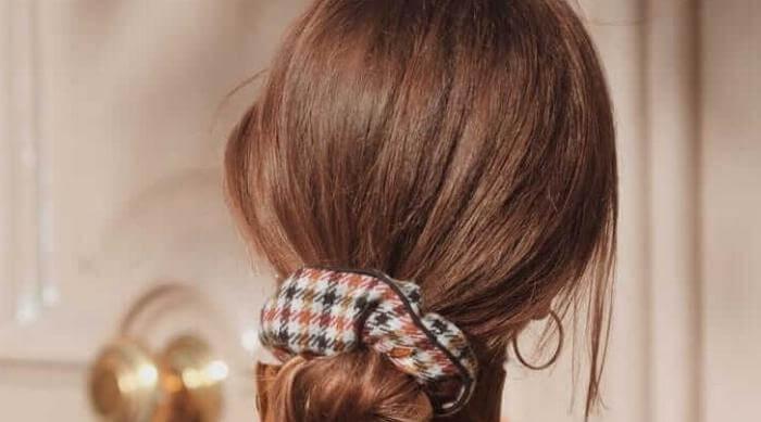 Woman Wearing a Patterned Scrunchie
