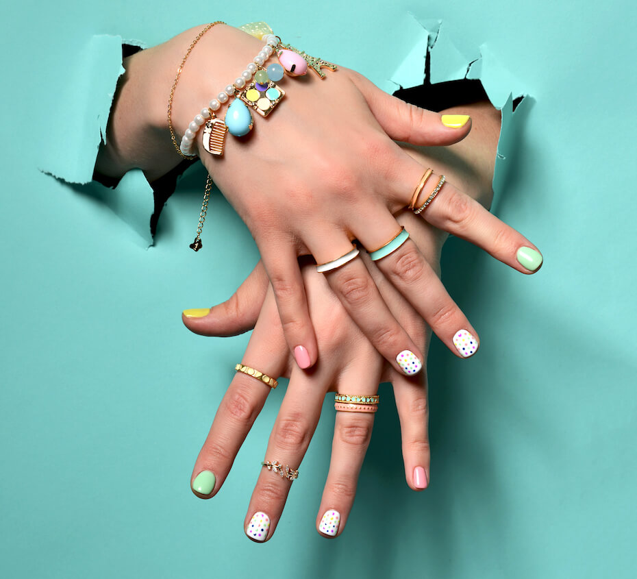 shutterstock-colorful-pastel-nails-and-rings-on-fingers-111319