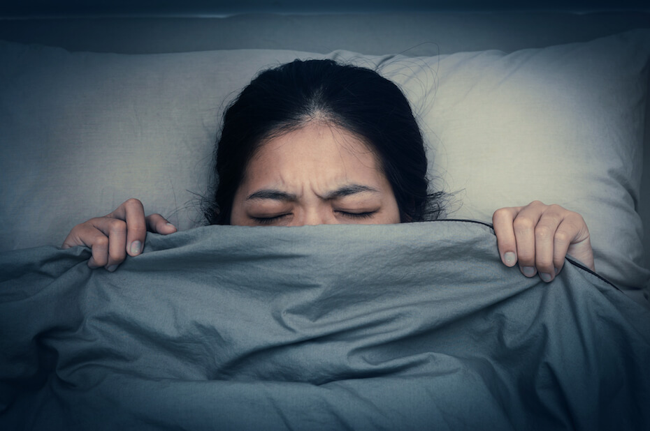 Unsplash: Woman not sleeping or having nightmare with blanket over face