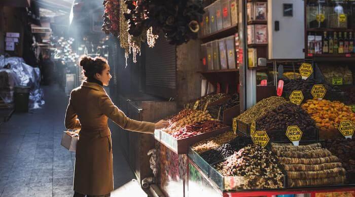 Shutterstock: Woman exploring shopping at a bazaar