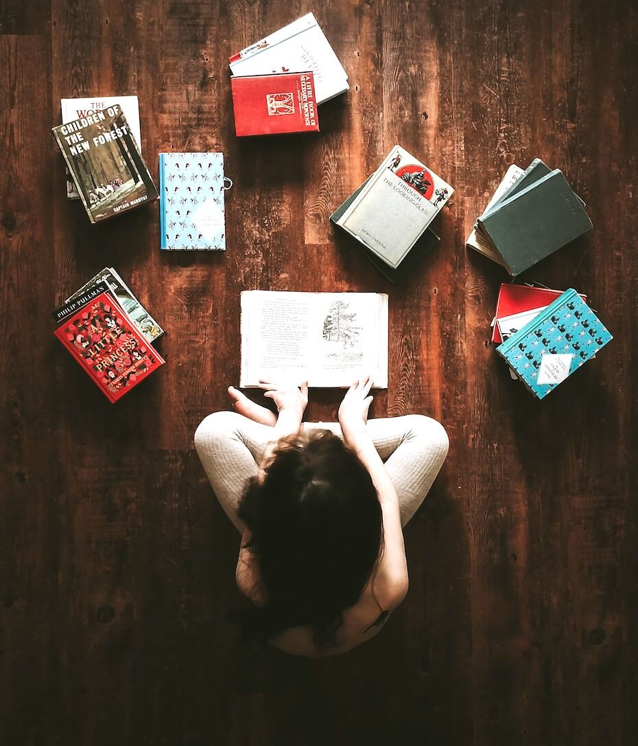 unsplash-annie-spratt-woman-on-floor-textbooks-laid-out-110719