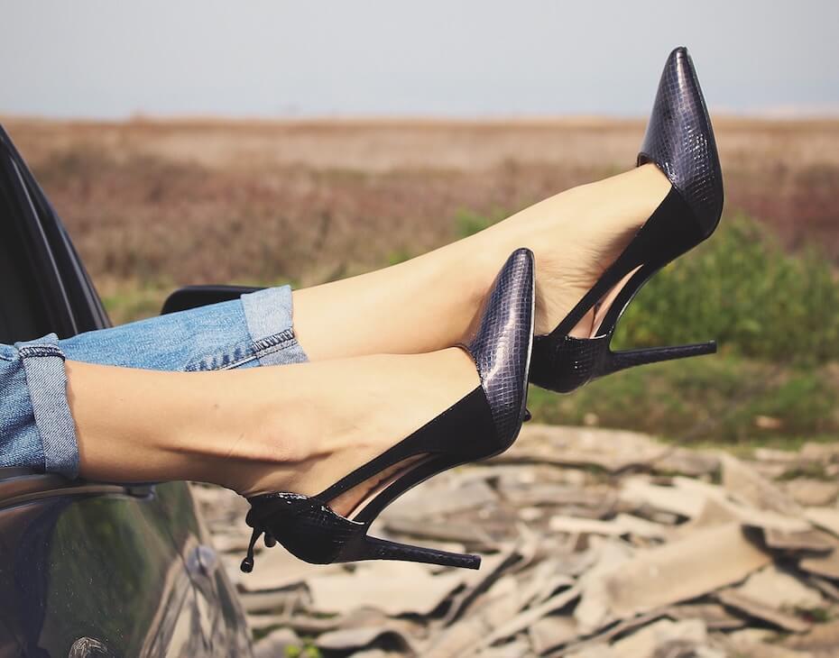 unsplash-apostolos-vamvouras-womans-legs-out-window-111819
