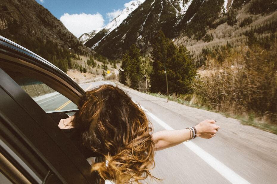 unsplash-averie-woodard-woman-on-the-road-head-window-112619jpg