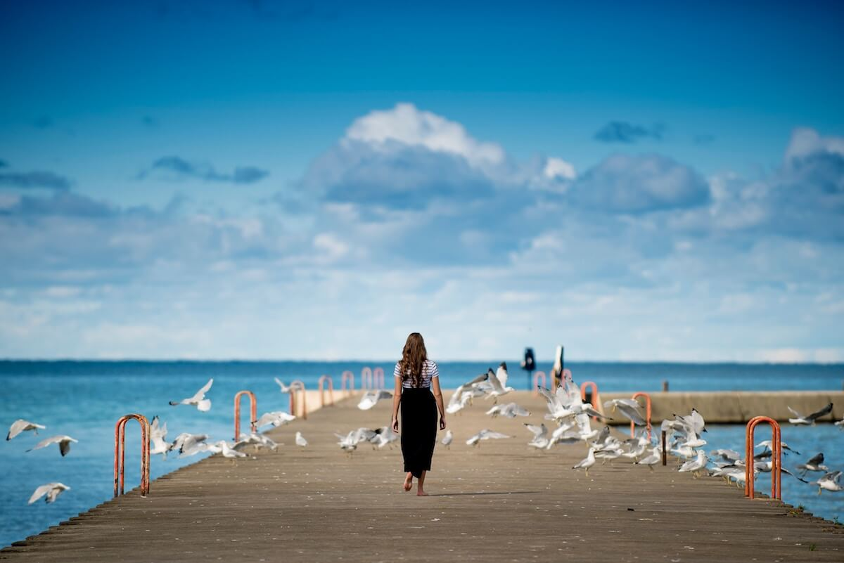 unsplash-ben-white-woman-on-dock-with-seagulls