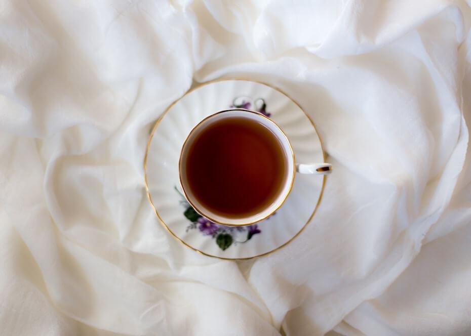 unsplash-carolyn-v-teacup-on-sheet-black-tea-110719