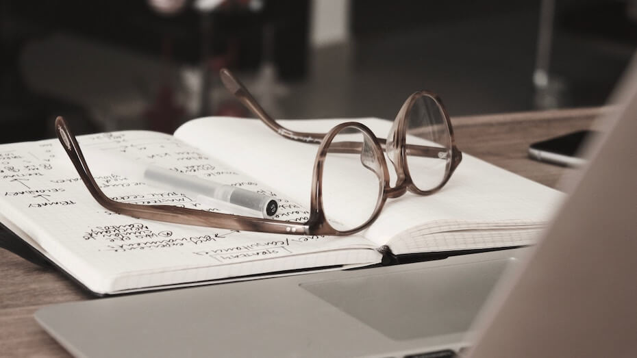 unsplash-dan-dimmock-glasses-resting-on-notebook-110719