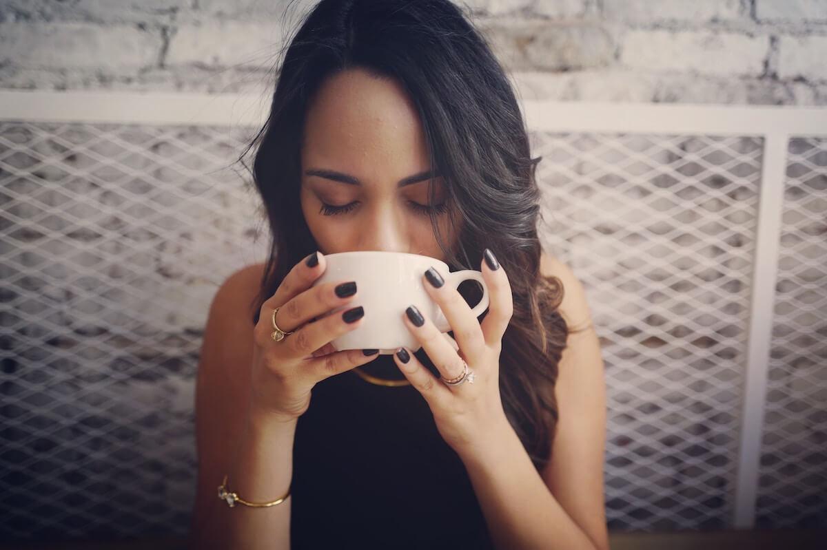 unsplash-drew-coffman-woman-drinking-from-mug