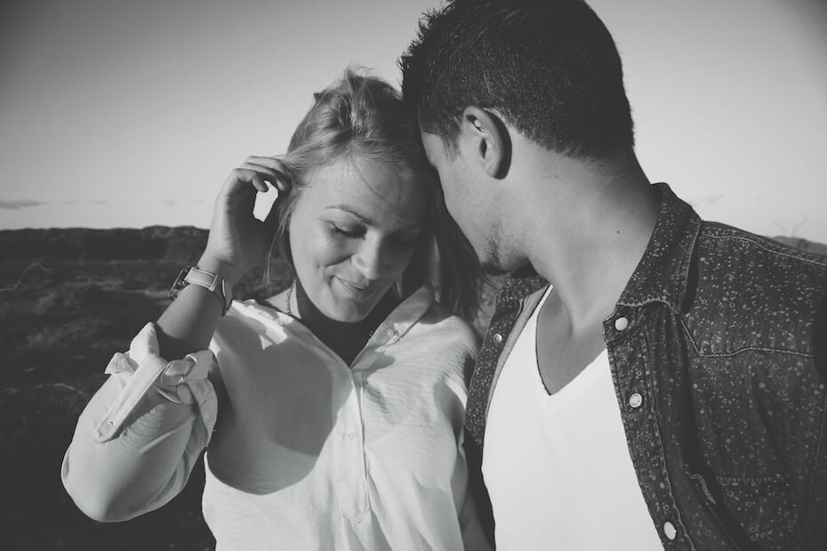 Unsplash: Black and white photo of woman flirting with man