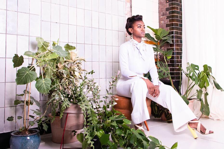 unsplash-jennifer-grube-woman-sitting-high-heels-plants-111819