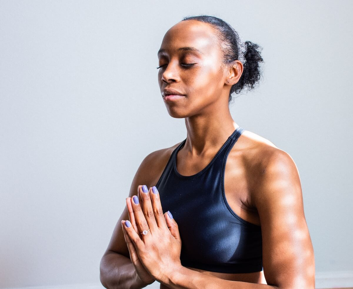 Unsplash: Woman meditating and doing yoga peacefully