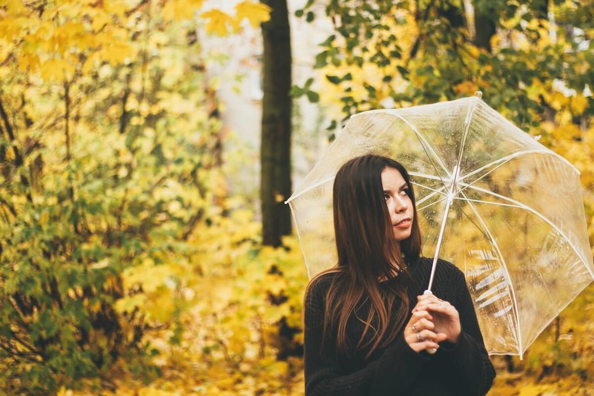 unsplash-mak-mozza-woman-with-umbrella-in-yellow-forest
