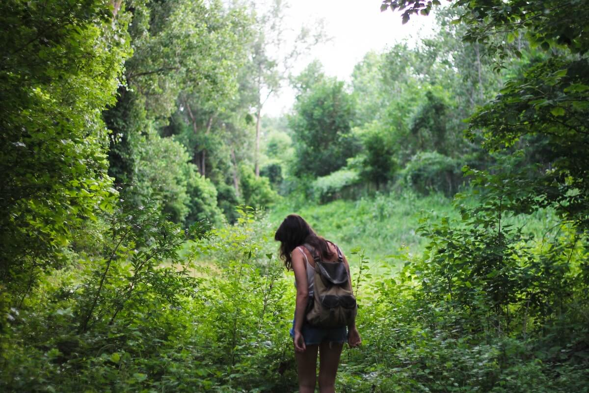 unsplash-michelle-spencer-woman-backpacking-alone-forest