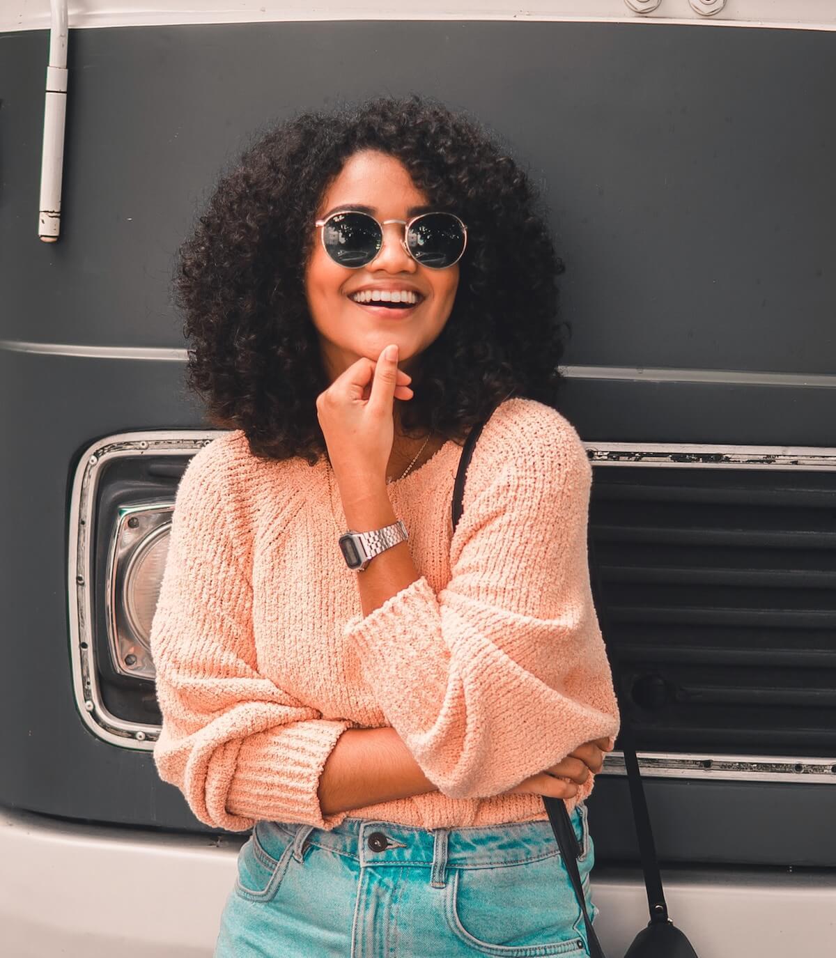 unsplash-philipe-cavalcante-woman-smiling-sunglasses-posing-bus