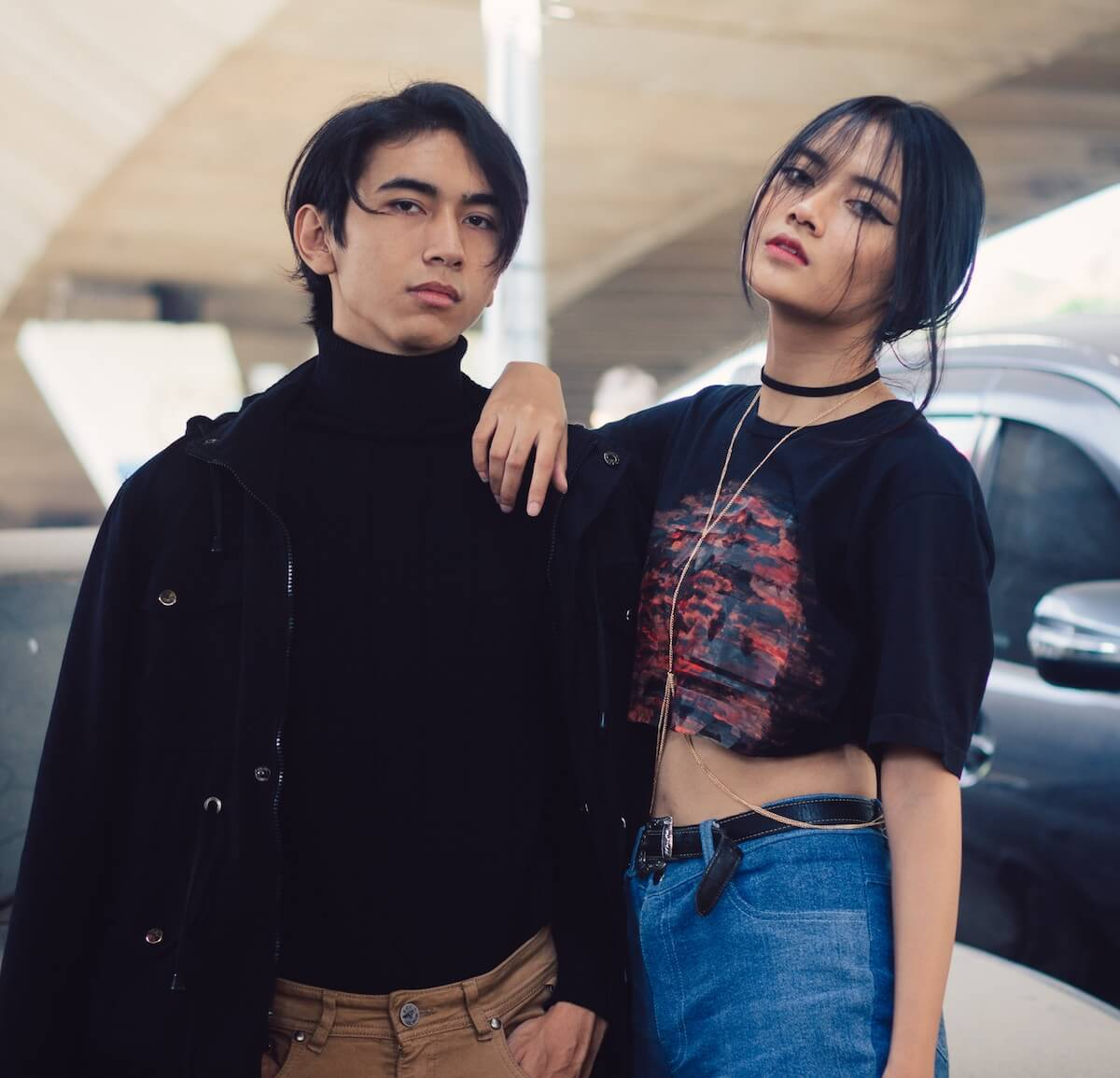 unsplash-riki-cool-couple-man-woman-in-front-of-cars