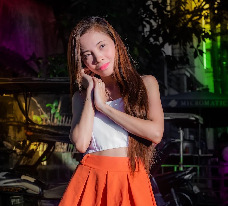 unsplash-vasile-stancu-woman-orange-skirt-looking-daydreamy-in-love-112619