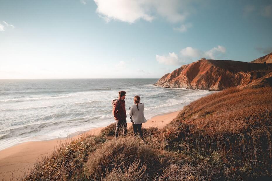 unsplash-will-truettner-man-woman-couple-looking-beach-111119